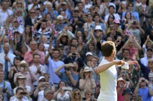 Andy Murray of Britain throws his wristbands into the crowd after defeating Mikhail Youzhny of Russia in their men's singles tennis match at the Wimbledon Tennis Championships, in London